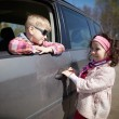 Girl and boy driving fathers car — Stock Photo #60069085