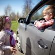 Girl and boy driving fathers car — Stock Photo #60069543