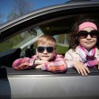 Girl and boy driving fathers car — Stock Photo #60069881