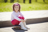 Little girl with skateboard for the walk — Stock Photo