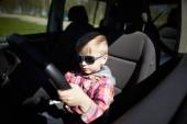 Boy driving fathers car — Stock Photo