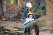 Boy and girl playing on construction site — Stock Photo