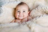 Cute baby portrait lying on fur — Stock Photo