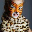 Little girl with tiger costume — Stock Photo #79969124