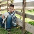 Boy with lamb on the farm — Stock Photo #80152870