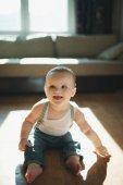 Cute little boy sitting on the floor — Stock Photo