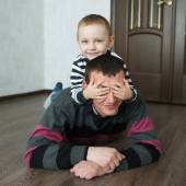Boy father lying on the floor at home — Stock Photo