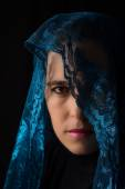 Middle Eastern woman portrait looking sad with blue hijab artist — Stock Photo