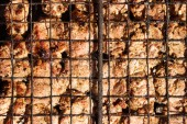 Meat on the grill grate — Stock Photo