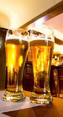 Beer glasses in bar — Stock Photo