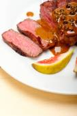 Green peppercorn beef filet mignon — Stock Photo