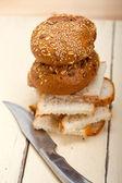 Organic bread over rustic table — Stock Photo
