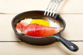 Egg sunny side up with italian speck ham — Stock Photo