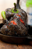 Charcol scorched fresh bell peppers — Stock Photo