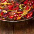 Fried chili pepper and vegetable on a wok pan — Stock Photo #57674581