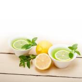 Mint infusion tea tisane with lemon — Stock Photo