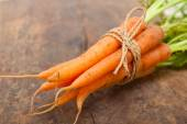 Baby carrots bunch tied with rope — Stock Photo
