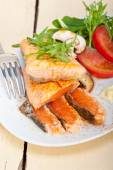 Grilled samon filet with vegetables salad — Stock Photo