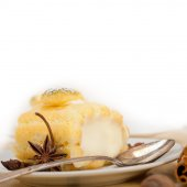 Cream roll cake dessert and spices — Stock Photo