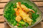 Fresh Japanese tempura shrimps with salad — Stock Photo