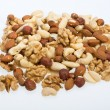 Mixed nuts - hazelnuts, walnuts, cashews, pine nuts isolated on white background — Stock Photo #52484623
