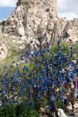 Evil eye in tree behind Uchisar Castle in Cappadocia, — Stock Photo