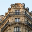 Corner of of typical house with balcony in Paris, France — Stock Photo #56412467