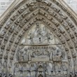 Paris - West facade of Notre Dame Cathedral. The Virgin Mary portal and tympanum — Stock Photo #57538931