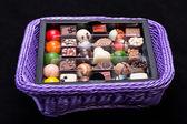 Set of a various chocolate pralines in lavender basket — Stock fotografie