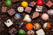 Set of a various chocolate pralines and coffee beans — Stock Photo