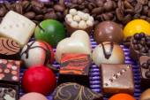 Set of a various chocolate pralines and coffee beans — 图库照片