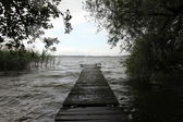 Old wooden pier at the lake — Stock Photo