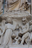 Paris - West facade of Notre Dame Cathedral. The Saint Anne portal and tympanum — Stock Photo