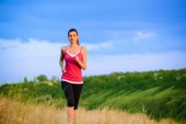 Young Beautiful Woman Running on the Mountain Trail in the Morning — 图库照片