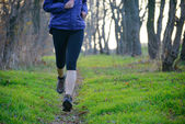 Young Sports Woman Running on the Forest Trail in the Morning — Stock Photo