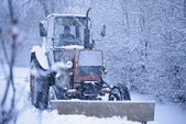 Tractor Cleaning Road from Snow in the Heawy Snowfall — Stockfoto