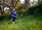 Young Beautiful Woman Running in the Park — 图库照片