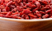 Wooden Bowl Full of Dried Goji Berries — Stock Photo