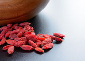 Heap of Dry Goji Berries on the Dark Table — Stock Photo