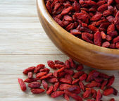 Wooden Bowl Full of Dried Goji Berries on the Table — Stock Photo