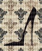 High Heeled Shoe on a Taupe Damask Background — Stock Photo
