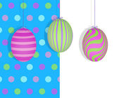 Easter Eggs Hanging on a Blue Polka Dot Background — Stock Photo