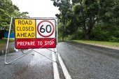Flooded road with sign — Stock Photo