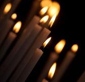 Burning white candles  — Stock Photo
