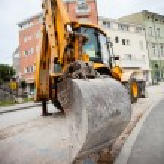 Excavator in a city — Stock Photo #73970075