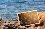 Lavagna con testo vacanze — Foto Stock