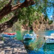 Boats on Lake Voulismeni. Agios Nikolaos, Crete, Greece — Stock Photo #64175395
