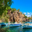 Boats on Lake Voulismeni. Agios Nikolaos, Crete, Greece — Stock Photo #65689789