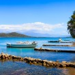 Fishing and pleasure boats off the coast of Crete. — Stock Photo #70504815
