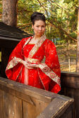 Portrait of a woman in Chinese princess costume in the pine forest — Stock Photo